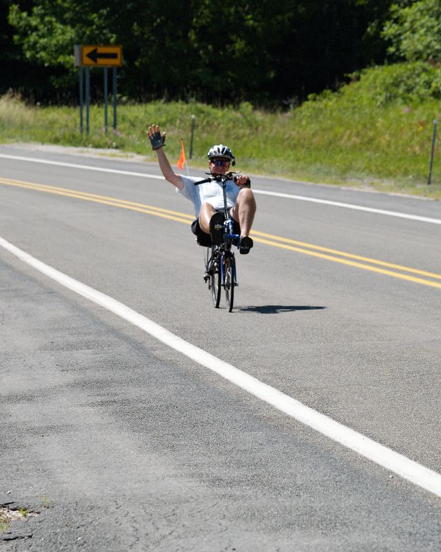 <font size=3>Another friendly wave from a rider on his way down Hill #2.</font>