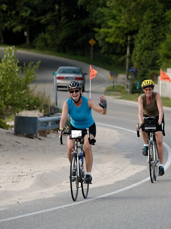 <font size=3>One thing I figured out quickly is most of the folks on the ride were very friendly.  Here a couple women give me a smile and a wave as they head past Orchard Beach State Park right on the Lake Michigan shore.</font>