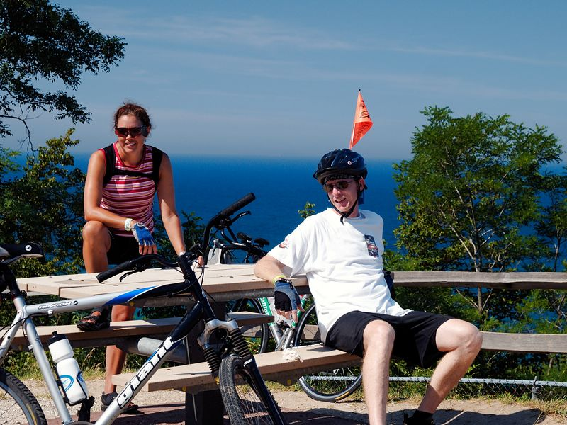 """<font size=3>A couple bikers rest after this hill.  The guy asked me I enjoyed taking photos of people in agony and the woman quipped """"No, just the agony of defeat.""""</font>"""