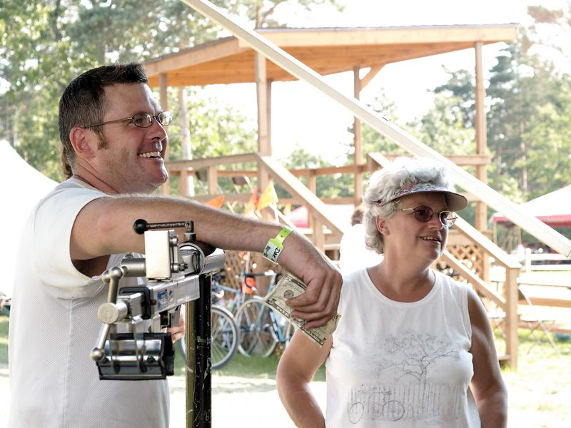 <font size=3>That's Dave.  He busted a couple spokes on the first day and went over to the repair trailer to see about picking up some replacements.  The woman standing next to him is the wife of the repairman.  According to him, she's the one in charge of the shop.</font>