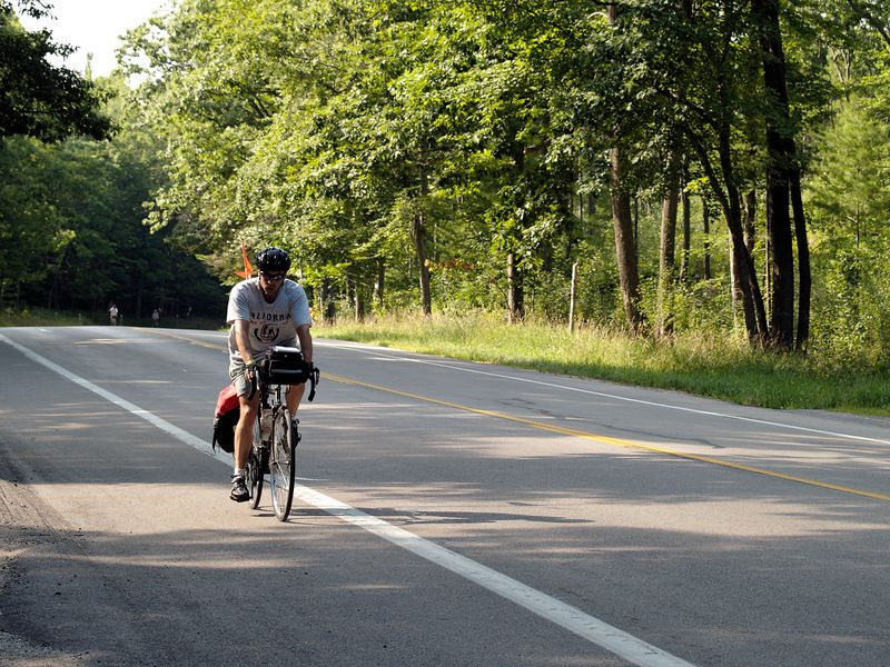 <font size=3>A rider heads down a small grade just outside of Onekema.</font>