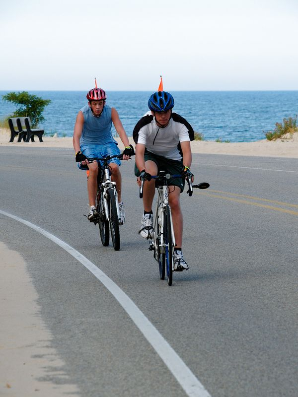 <font size=3>Now you can see what the previous rider was so interested in as these young men leave Orchard Beach behind.</font>