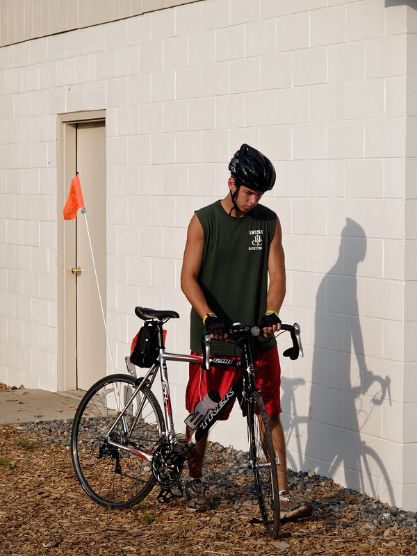 <font size=3>I'm sure you're beginning to see that there were participants of all ages.  This young man is leaving the camp site to start his ride for the day.</font>