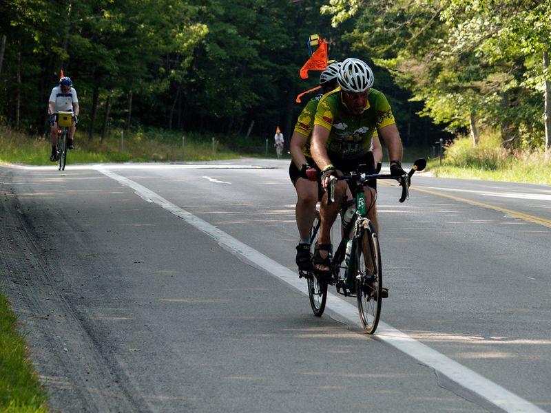 <font size=3>Several couples were riding tadem bikes together.</font>