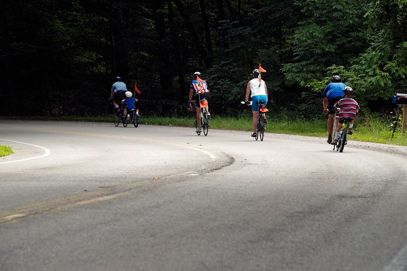 <font size=3>Several families attended the ride.  Here three generations head down Snotty Little Hill.</font>