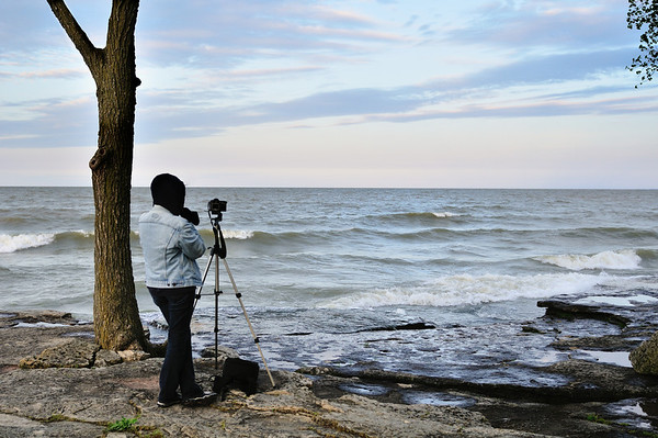 Photographer waits for the Super Moon rise.