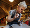 Karen Brinson, of Bettendorf, molds pottery in her barn/studio outside of her house on Monday, Sept. 28, 2015.