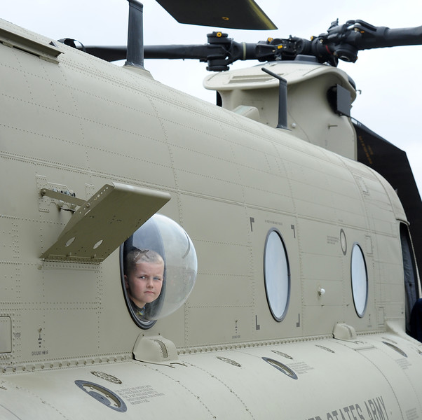 Bennett Gorgal, 8, Moline, looks out a bubble window on a U.S. Army helicopter at the Quad City Air Show Saturday, May 9, 2015, at the Davenport Municipal Airport in Mt. Joy. The 29th annual airshow continues Sunday.
