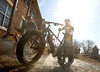 Max Oliver, Davenport, uses a power washer to take some of the mud off his bike  at the Friends of Off Road Cycling Frozen Fat FONDO Fest II at Credit Island Park, Saturday, February 6, 2016<br />  (Photo by Todd Welvaert / twelvaert@qconline.com)