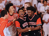 UTHS' De'Ante Walker and Tray Buchanan celebrate with their teammates after beating Rocky 49-45, Friday, January 15, 2016.