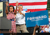 First lady Michelle Obama and President Barack Obama, wave to well-wishers during a stop in the Village of East Davenport, Wednesday, August 15, 2012. The visit concluded the president's three-day campaign tour through Iowa.