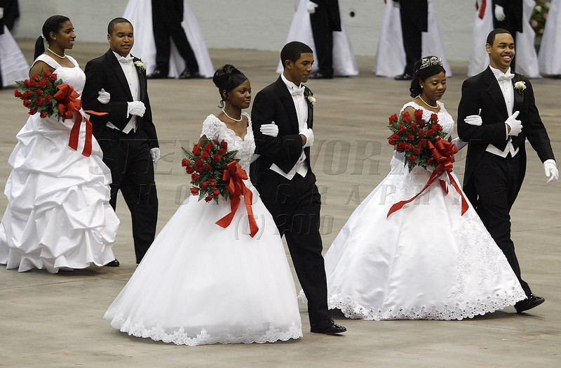 Debutantes are escorted by their marshals during the Alpha Kappa Alpha debutante ball in November 2007 at the Dorton Arena in Raleigh.