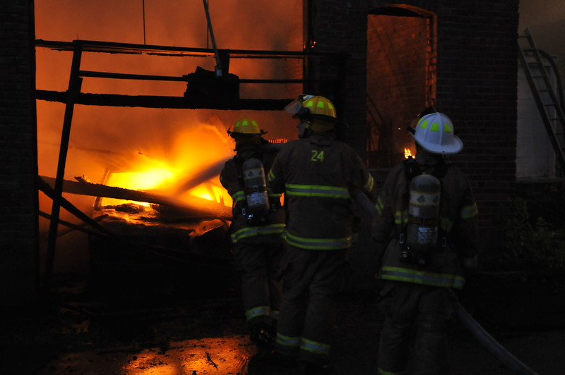 Firefighters fight an inferno in a heavily damaged building around 4 a.m. in Prophetstown's downtown district, Monday, July 15, 2013. The early morning fire destroyed eight buildings in Prophetstown's downtown district. Although the fire swept through several apartments above the businesses. Residents and firefighters were able to evacuate everyone and no one is believed to have been injured. More than 30 fire departments, some from as far away as Paw Paw, Sublette, and Savanna, and Comanche in Iowa,responded to calls for help. Fighting the fire drained the town's water tower, nearby Lyndon's water tower, and had firefighters and private residents trucking water to the scene from the nearby Rock River. Neighbors reported hearing popping sounds around 2 a.m. and awoke to the downtown ablaze. Prophetstown Mayor Steve Swanson said the damage is terrible. He said the city's historical society was heavily damaged in the fire.