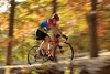 A cyclist spins through the colors of fall along the bike path at Devil's Glen Park in Bettendorf, Monday, October 19, 2015.