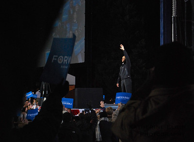President Barack Obama waves to the crowd at a rally in Bristow, VA.