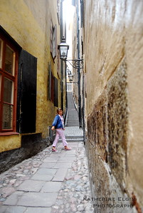A young girl walks through the narrow streets of Stockholm's Old Town.