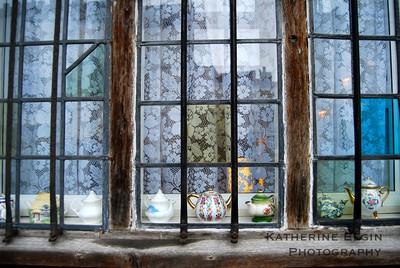 Teapots sit in a Stratford-upon-Avon windowsill.