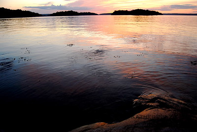 The sun sets over the Swedish archipelago.