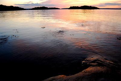 The sun sets over the Swedish archipelago.