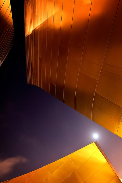 Philharmonic #0<br /> <br /> The moon shines at the Walt disney concert hall<br /> <br /> I took a bunch of shots to this amazing building during my visit to LA, I was lucky it was a block away from my hotel.<br /> <br /> Nikkor 16-35mm @ f11.