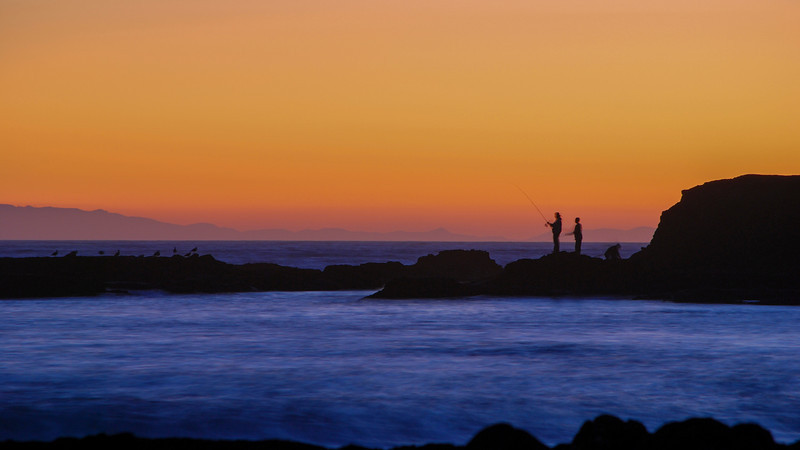 A family fishing at sunset.  Laguna Beach 2008
