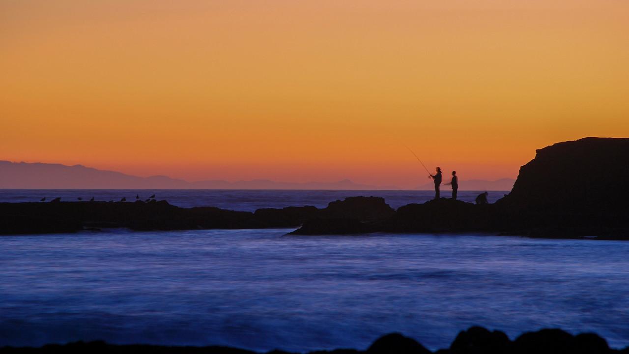 A family fishing at sunset.  Laguna Beach 2008