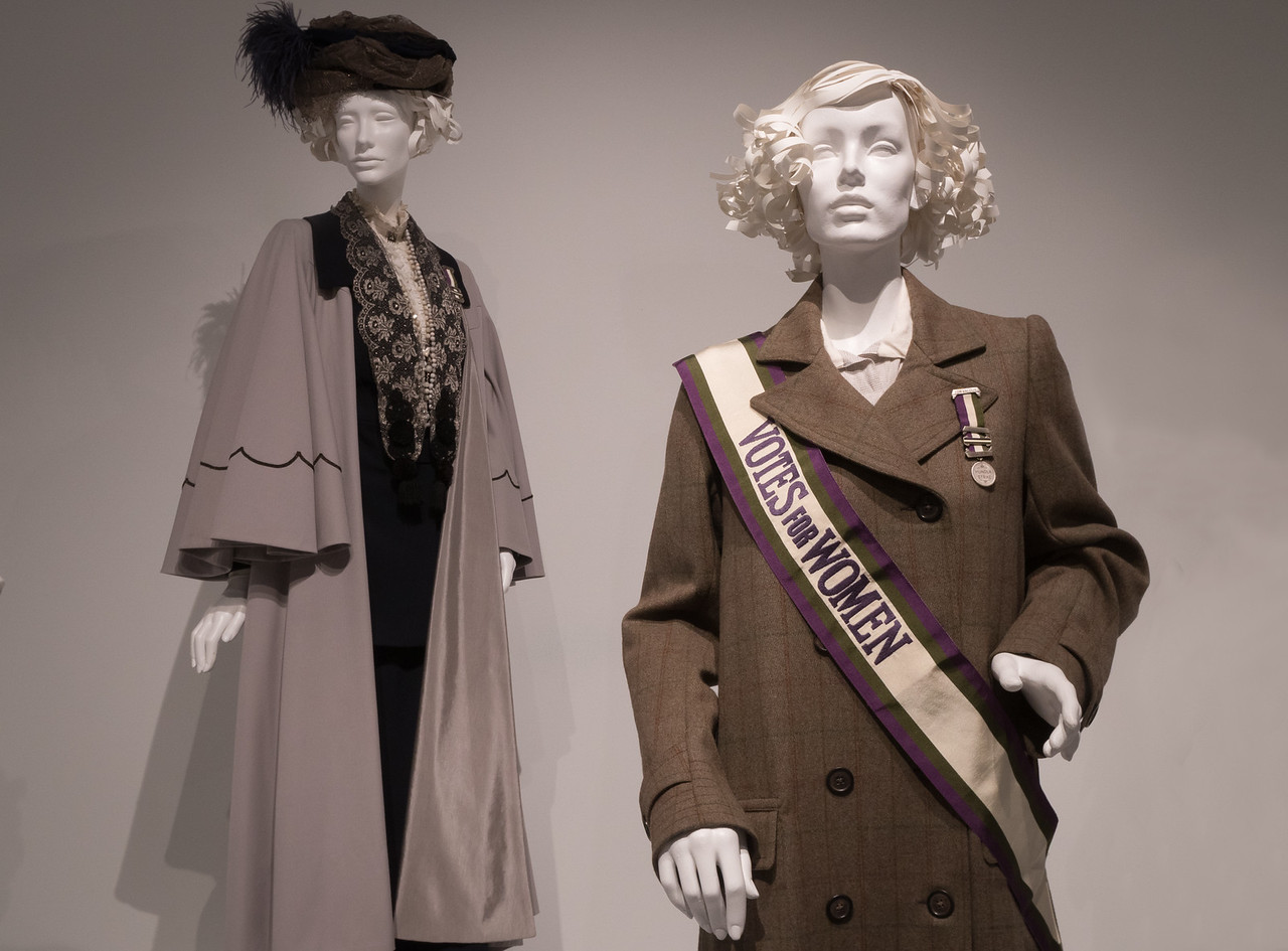 Two mannequins wearing costumes from Suffragette