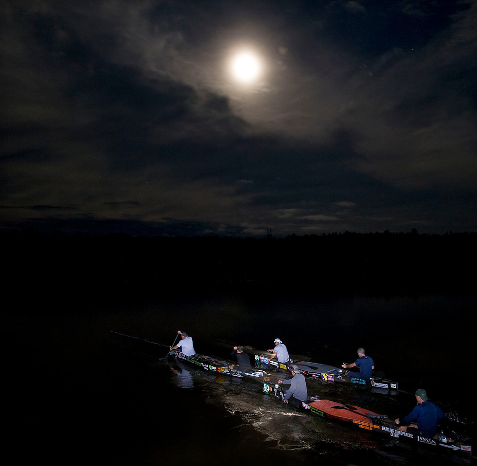 7/24/10 -ALL - CA pack of canoe paddle under moonlight during the The 63rd annual AuSable River Canoe Marathon in Grayling, Michigan on July 24 and 25th, 2010.  A record 94 teams began with a Lemans-style running start, portaging 6 dams and paddling 120 miles to the finish in Oscoda Sunday.