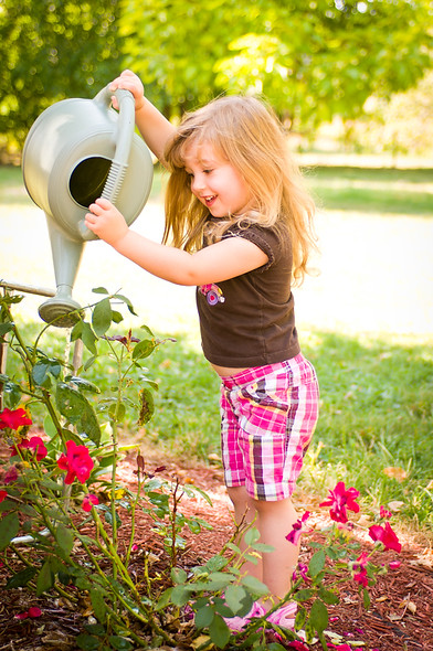 Kaydance Sneed, Tilly, flowers, red rose, rose, watering, watering flowers,