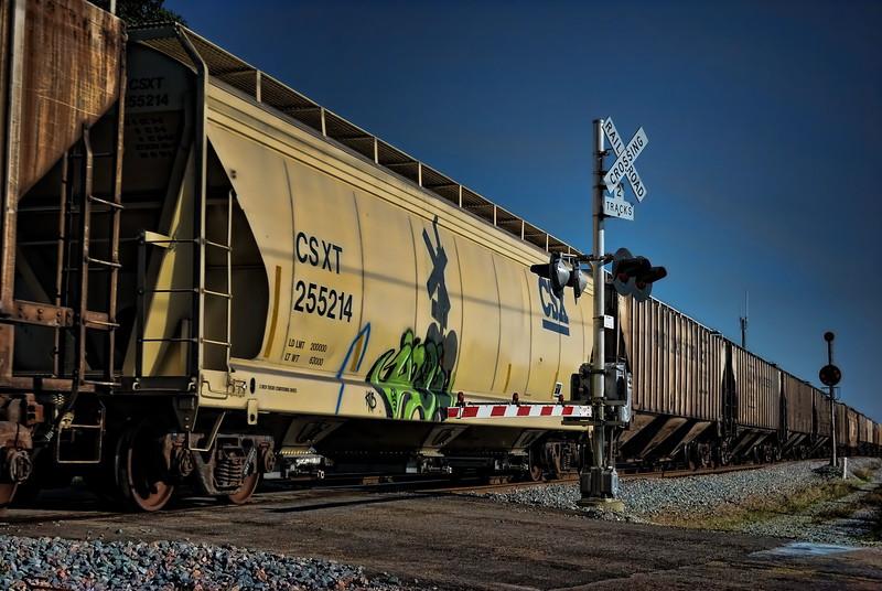 CSX hopper car with graffiti.
