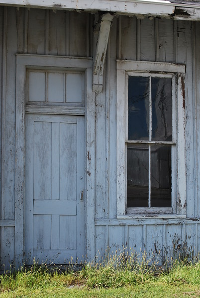 Door and window of an old abandoned train station in Spencerville, Ohio