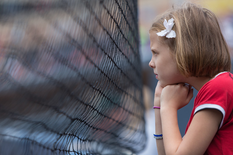 Young girl behind home plate