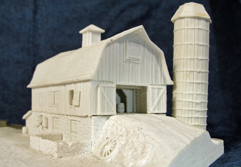 Detail: Barn sculpted and cast with interior details.