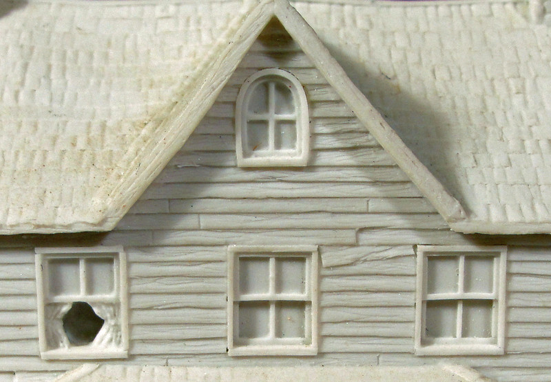 Detail: Close up of sculpted detail.  Open window, sagging and weathered clapboard and shingles are realistically portrayed.