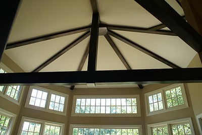 Architectural beam ceiling detail in farmhouse living room addition.