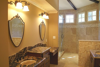 New farmhouse master bath:  Her vanity pictured.   Toilet is located behind knee wall on his vanity side.  Entire left side of vaulted octogon addition is the new shower.
