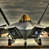 Three shot HDR image of an F-22 on the ramp at the 2009 Capital Airshow in Sacramento. Monopod used. I hope to edit out the security ropes.