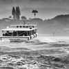 Rain storm and wind buffet ferry with tourists returning from USS Arizona memorial at Pearl Harbor on Oahu, Hawaii.