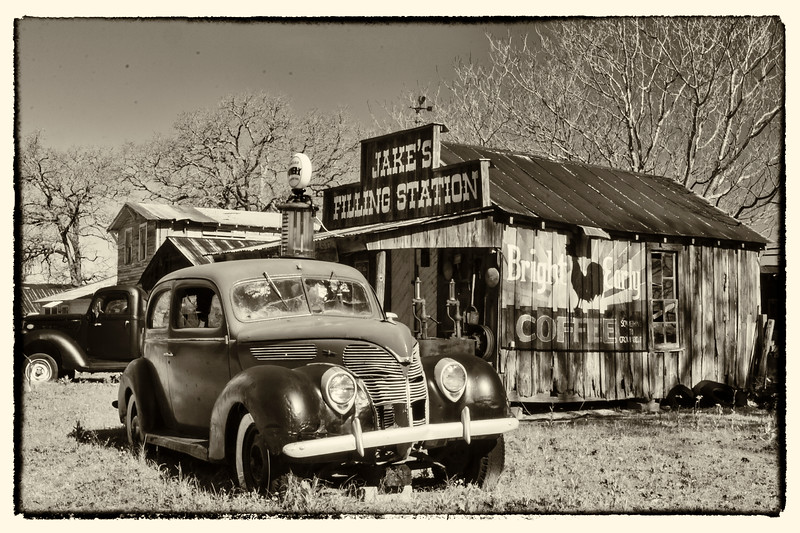 Antique buildings and vehicles in Salmon Lake Park near Crockett, Texas.