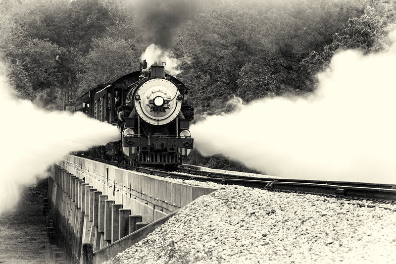 """Blowdowns from 1917 Baldwin """"Pershing"""" steam engine locomotive 300, Consolidation classification, crossing Neches River Bridge (runbys) during 2012 Railfest Photoexcursion weekend, at Texas State Railroad which runs between Rusk and Palestine, Texas."""