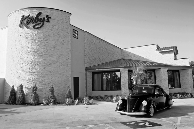 Kirby's Steak House in the Woodlands, Texas, with classic car from Gullo Classic Auto Museum in Magnoia, Texas.