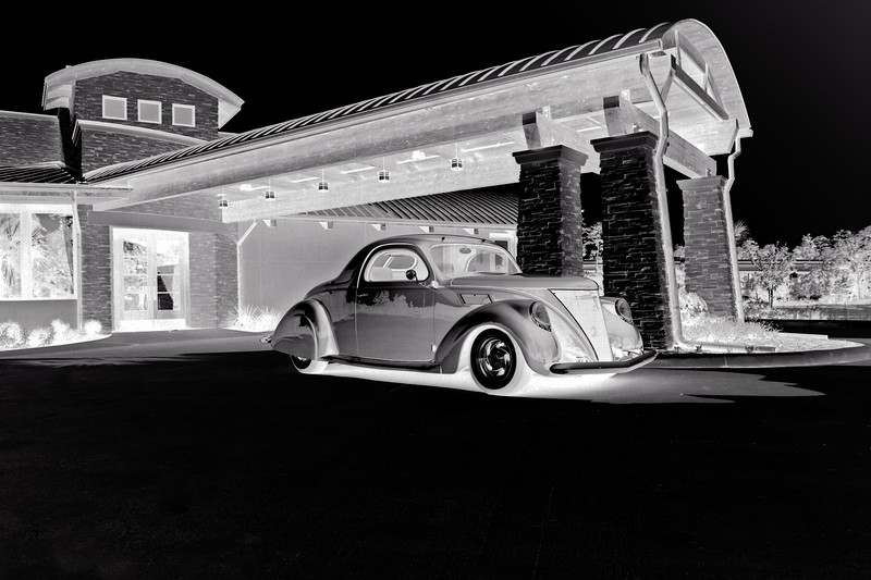 Classic car from Gullo Classic Car Museum parked at Kirby's Steak House. Negative, reversed, image.