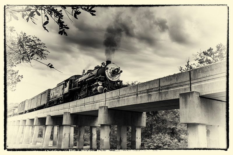 "1917 Baldwin ""Pershing"" steam engine locomotive 300, Consolidation classification, crossing Neches River Bridge during 2012 Railfest Photoexcursion weekend, at Texas State Railroad which runs between Rusk and Palestine, Texas."