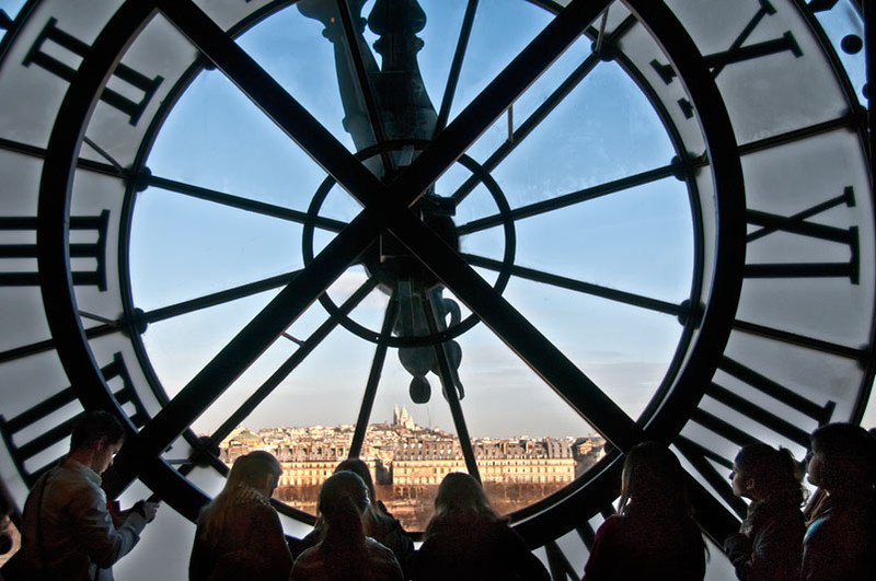 Paris, viewing Montmartre and Sacre Coeur through clock at Orsay Museum