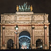 Paris, Ferris wheel seen through small Arc de Triomphe