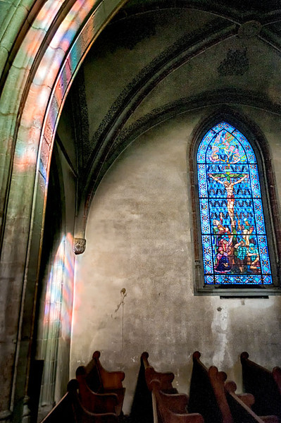 Stained glass reflections in Nyon, Switzerland cathedral