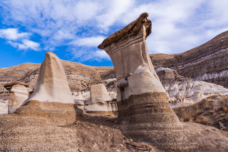 Hoodoos in the Canadian Badlands in Alberta, Canada. East of Drumheller, the Hoodoo Drive Trail (Hwy 10) is named for these oddly shaped rock formations that look like petrified mushrooms.