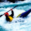 Whitewater kayaker in the Boulder Drop rapid on the Skykomish River, Washington state.