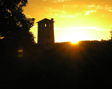An October sunrise creates a silhouette of the water tower at Ha Ha Tonka State Park.