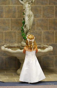 Flower girl watching the fountain prior to the wedding.